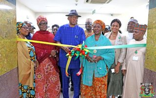 The Representative of the Managing Director, Nigerian Ports Authority (NPA), the Executive Director, Marine & Operations, Dr. Sokonte Davies unveils the commemorative banner during the occasion. (PHOTOS – NPA MEDIA)